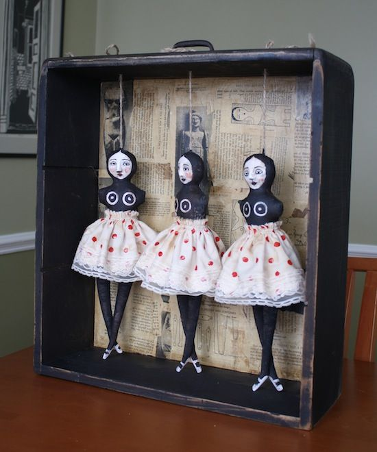 Shadow box dolls.