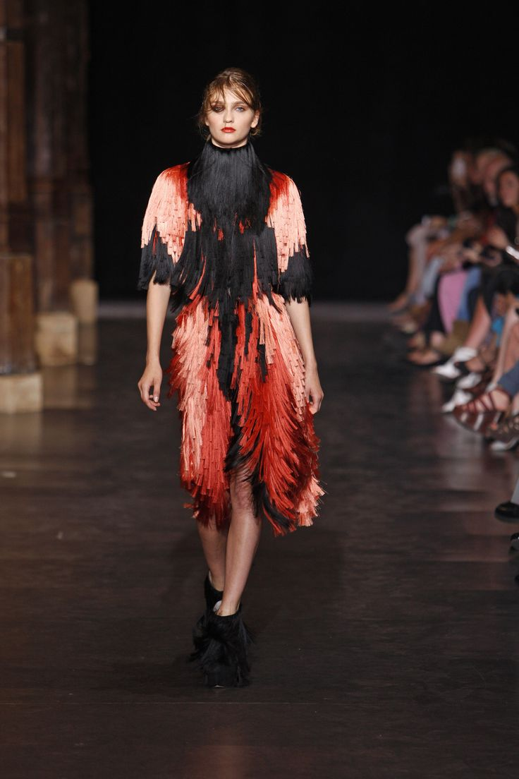 Below knee length couture dress with fringes