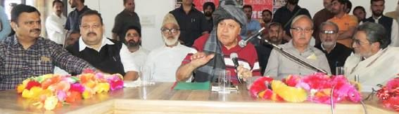 National Conference President Dr Farooq Abdullah addressing party workers at Surankote.
