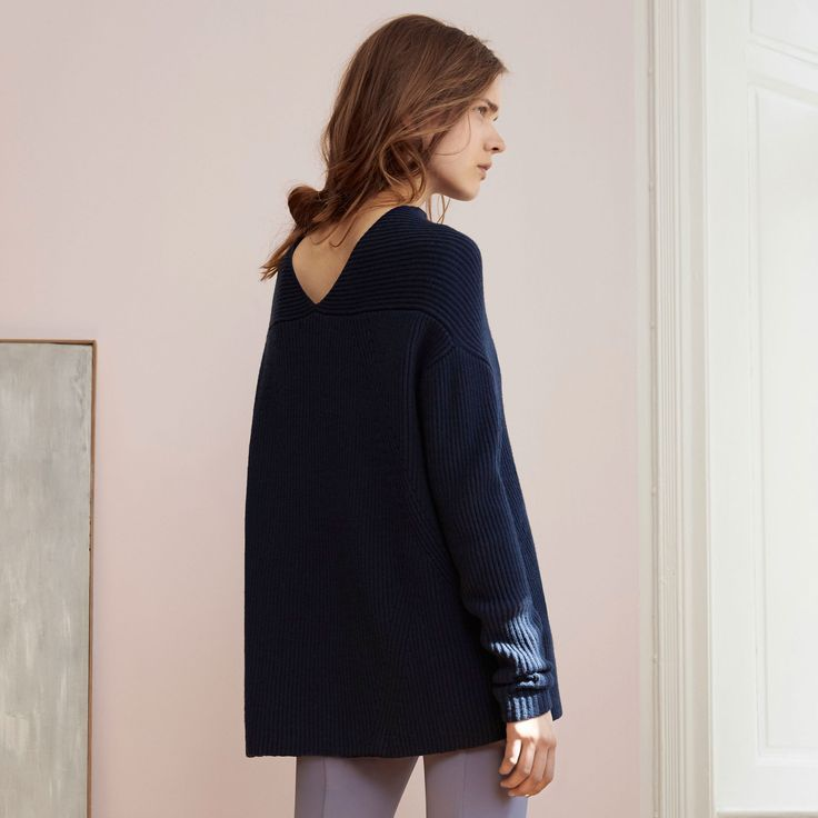 FWSS Getting Nowhere is a chunky sweater knitted from a beautifully soft wool. Slightly A-line shaped with a cowl neck and V-shaped detail at back.