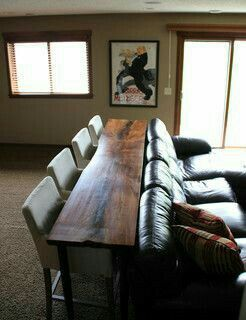 Bar table behind the couch for the basement