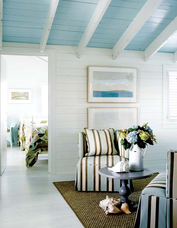 white clad bead board walls, blue ceiling, nautical stripe, lovely rug and a lovely pitcher of flowers!
