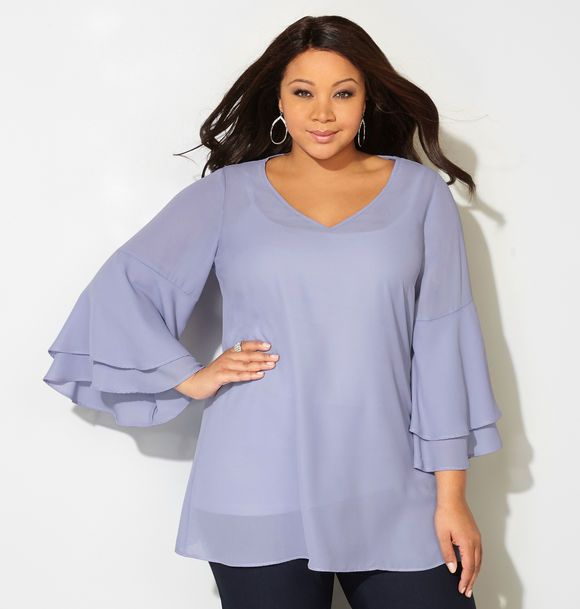 6f95450f62 Shop romantic new plus size blouses in sizes 14-32 like the Ruffle Sleeve  Blouse available online at avenue.com. Avenue Store