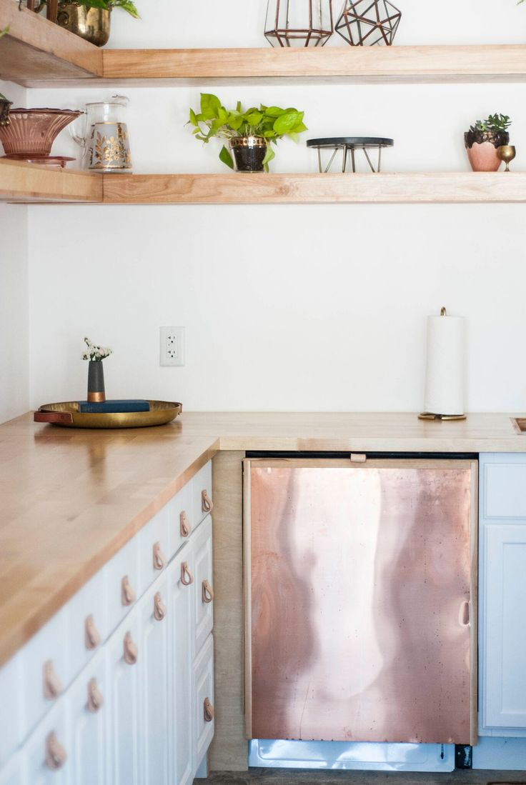 Scandinavian Inspired Kitchen with Leather Hardware and a Copper Panel DIshwasher via Birch & Brass Vintage Rentals for Weddings and Special Events in Austin, Texas