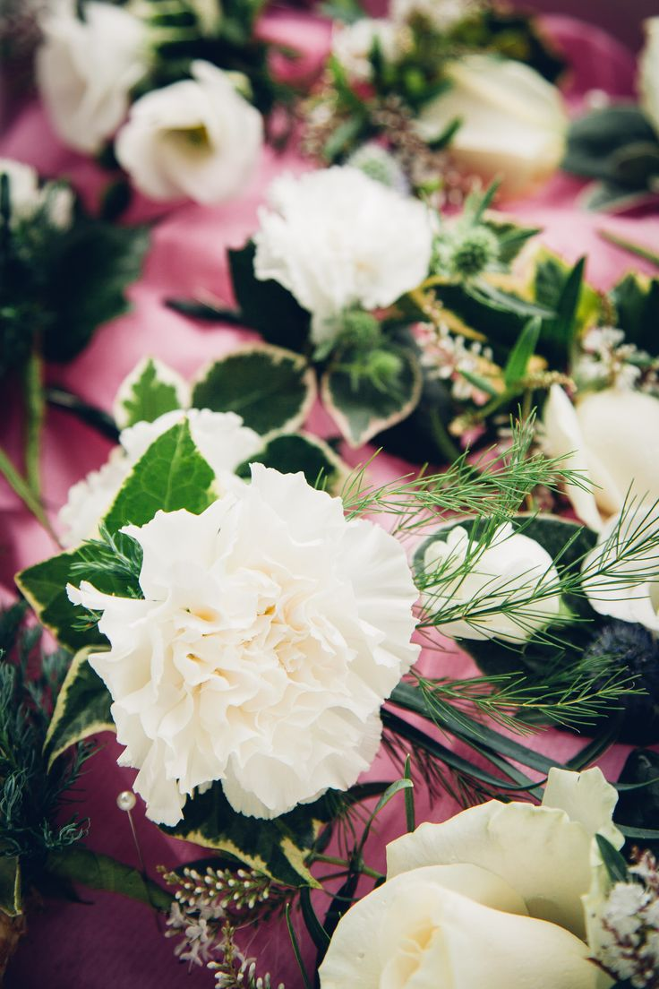 Ushers' buttonholes - varied cream flowers and greenery