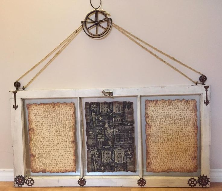 Large vintage window was given the steampunk treatment with the addition of gears and an antique clothesline pulley.