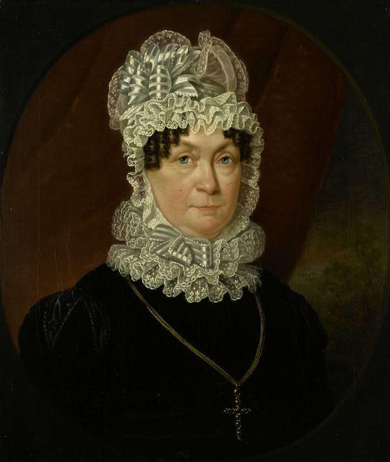 Jan Willem May | Portrait of Ann Brander (died 1837), Wife of Job Seaburne May, Jan Willem May, 1823 | Portret van Ann Brander, de echtgenote van Job Seaburne May. Buste in ovaal, naar rechts. Een witte kanten muts op het hoofd, een kruis aan een ketting om de hals. Pendant van SK-A-2423.: