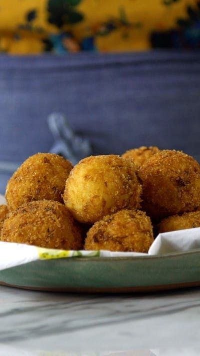 Deep-fried and stuffed with cheese, these risotto bites are ridiculously yummy.