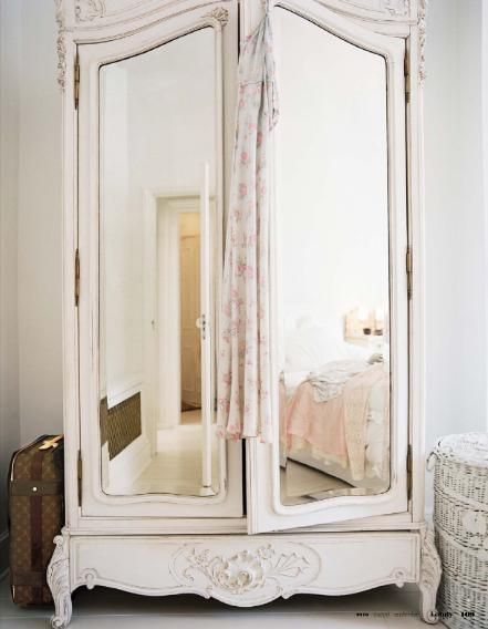 Would make room look bigger! :) shabby chic vintage mirrored armoire