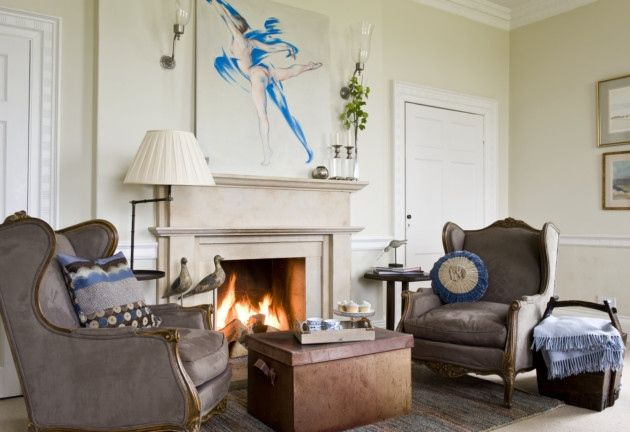 Marion is big fan of original art and chose this James Wedge painting as the focal point of the dining room. Armchairs, similar from The French House; Fenton storm wall lights in nickel from Vaughan Designs; fire surround from The Stone Fireplace Company, York, large leather-look box bought years ago from the Holding Company in London; wall colour Farrow