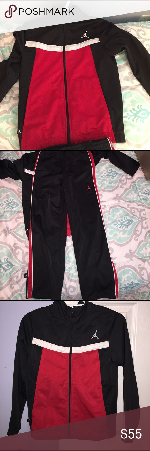 Sweat suit-Jordan Sweat shirt-  medium, black and red with white.    Sweat pants- small, Black with red down the side of the pants t Jordan Matching Sets