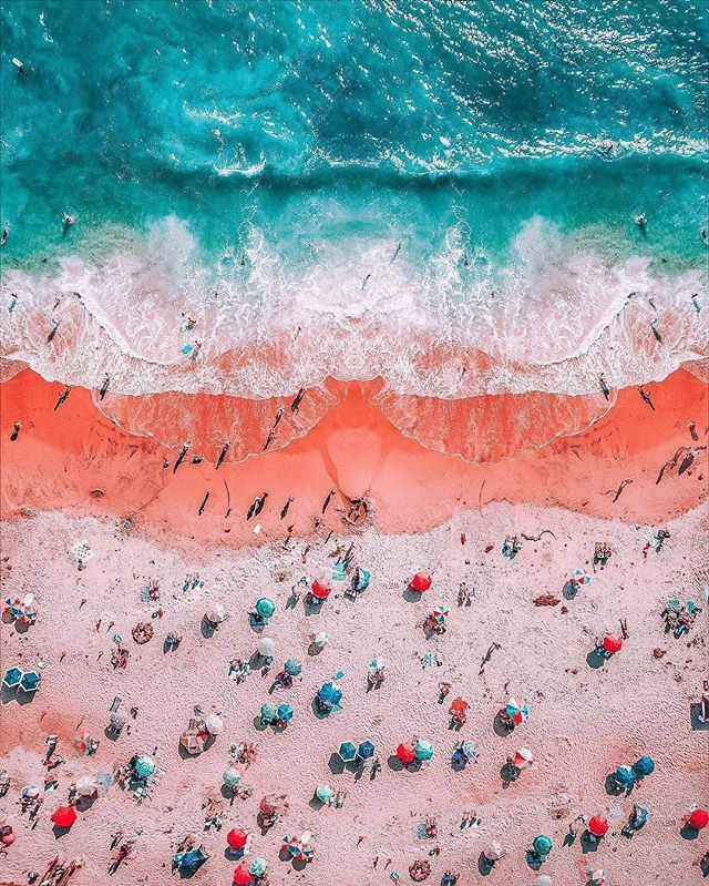photographer niaz uddin captured this colorful aerial image of california's Laguna beach, contrasting the azure blue of the ocean with the coastal town's orange-pink sands. photo by neohumanity