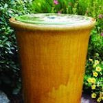 Water feature: Made with two glazed pots (a shallow bowl nests snugly inside the larger pot), a bucket, and a small recirculating pump.