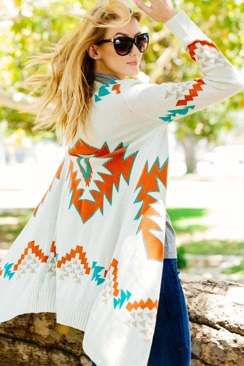 POLYESTER SPANDEX KNITTED OPEN FRONT CARDIGAN WITH TASSEL AND AZTEC PATTERN.