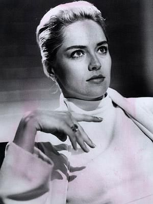 Catherine Tramell(Sharon Stone) looking like a quintessential Hitchcock blond in Basic Instinct. Think The Birds or Vertigo.