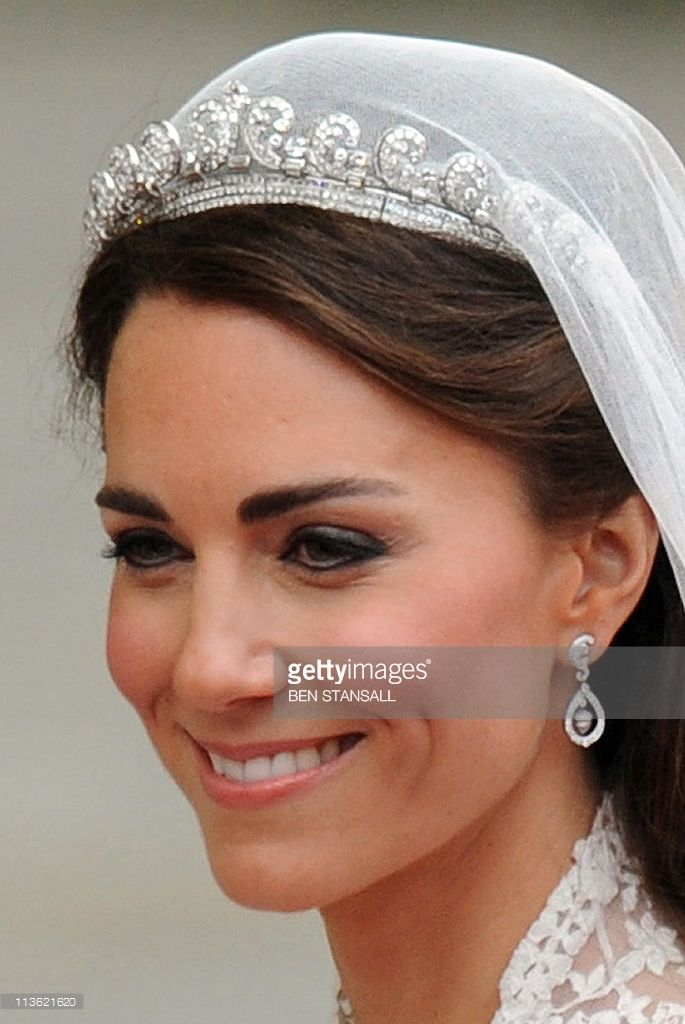Britain's Prince William's  wife Kate, Duchess of Cambridge, smiles as they travel in the 1902 State Landau carriage along the Processional Route to Buckingham Palace, in London, on April 29, 2011. AFP PHOTO / BEN STANSALL (Photo credit should read BEN STANSALL/AFP/Getty Images)