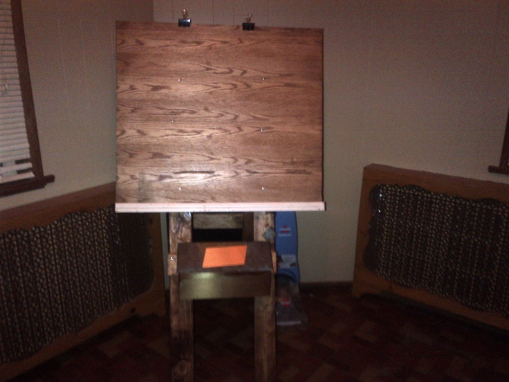 Art easle I put together from scrap wood and a old mailbox. Total investment 3 bucks for hinges.