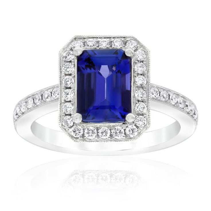 Rare and beautiful. Kilimanjaro tanzanite and diamond dress ring. This emerald cut tanzanite is a deep, bright bluish-purple colour. Crafted in 18ct white gold. This ring will be customised to perfectly fit your finger, which may take up to 6 weeks