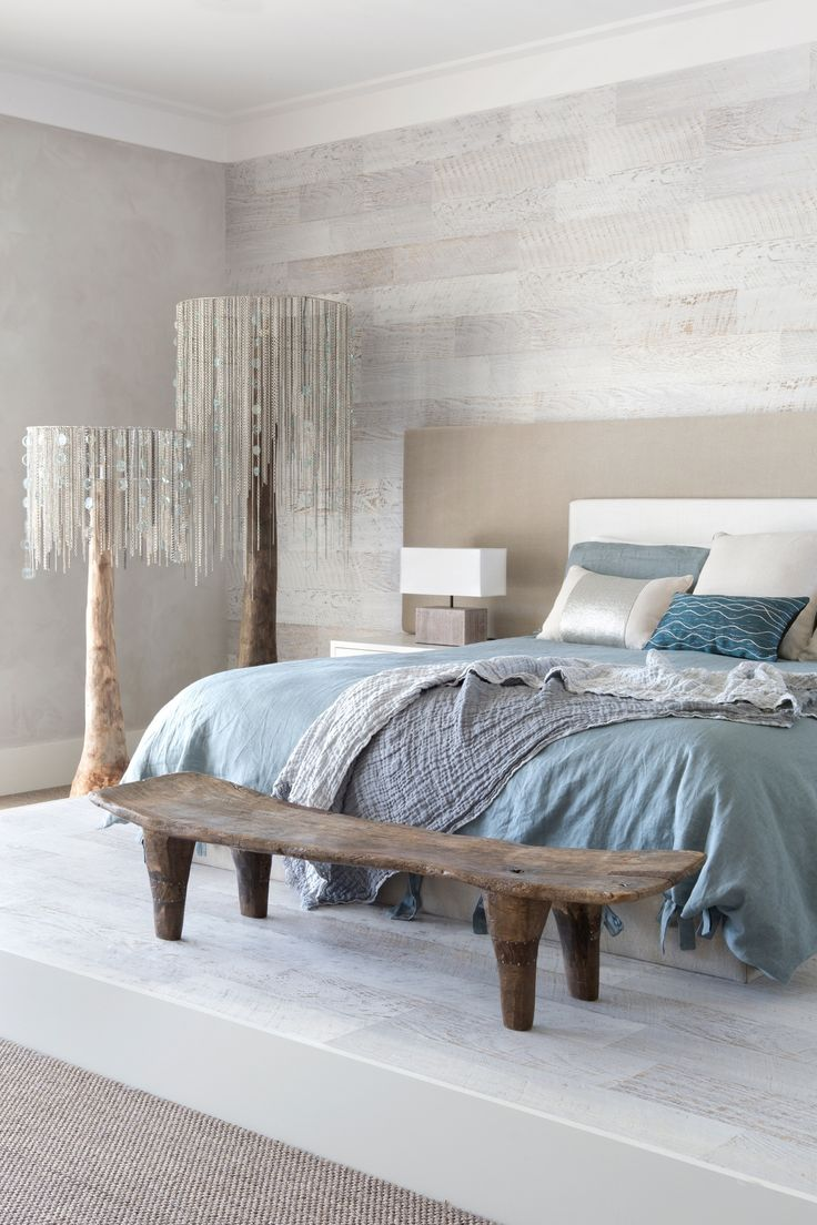 Soft blue bedding accented against a neutral wall. Aren't those lamps just to die for?
