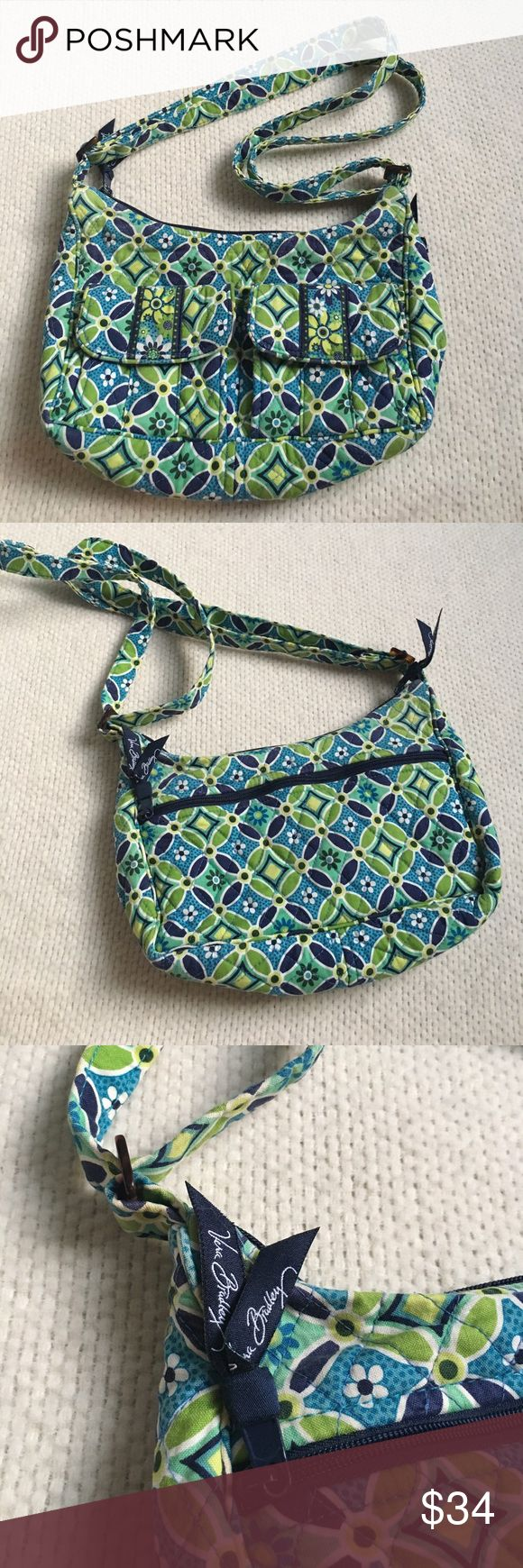 Vera Bradley Handbag with Adjustable Straps Vera Bradley Handbag with Adjustable Straps. Features a zip closure to the main pocket, an outside zip pocket, two outside pockets with snap closures, and two pockets on the inside. Excellent condition. Vera Bradley Bags Shoulder Bags