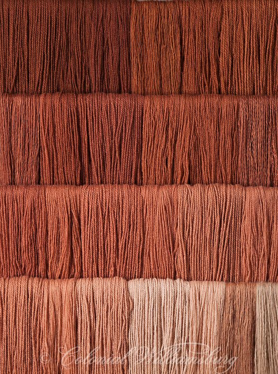 Studio photography of various colors of yarn dyed at the Weaver's shop in Colonial Williamsburg. Shot for book by Max Hamerick on dyeing textiles; Brown dyed with Walnuts. Photo by Barbara Temple Lombardi.