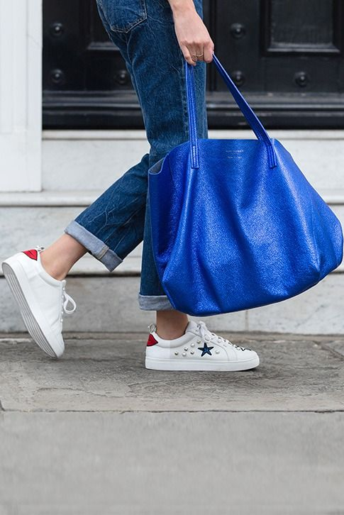 Blue Tote Bag.  Crafted in rich, supple leather with light pebbling, the Violet Horizontal Tote from Kurt Geiger London brings instant polish to your everyday accessories. Crafted in Italy, this relaxed handbag is roomy enough for even the busiest days