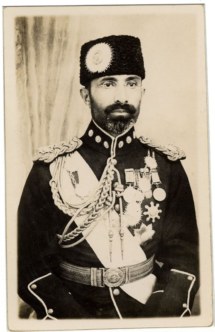 Photograph of  Muhammad Nadir Shah, King of Afghanistan (1929-33), standing in uniform and with medals and orders.