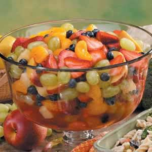 """Fruity Rainbow Salad Recipe -""""This is a beautiful salad with all of its colorful fruits,"""" confirms Teri Lindquist from Gurnee, Illinois. """"You can use other produce as well, such as melon balls, bananas, apples and such. The sweet and tangy marinade gives the salad a refreshing zip."""""""
