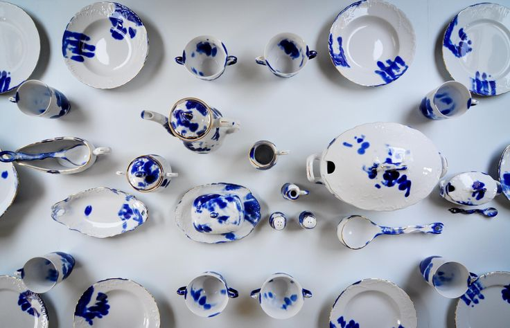 The production line of Poland's oldest porcelain factory has been sabotaged – so a batch of its traditional tableware is stained with workers' fingerprints