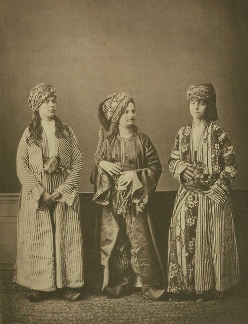 a kurd, an armenian, and a turkish woman pose for a photo. sivas, ottoman empire. 1870s.