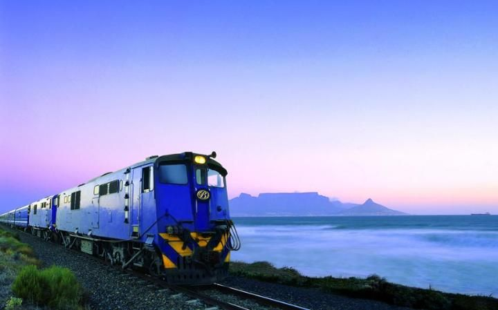 The Blue Train, with Table Mountain in the distance, lives up to its name
