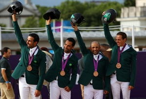 (L-R) Bronze medalists Hrh Prince Abdullah Al Saud, Kamal Bahamdan, Ramzy Al Duhami and Abdullah Waleed Sharbatly of Saudi Arabia celebrate on the podium during the medal ceremony for Team Jumping of the London 2012 Olympic Games