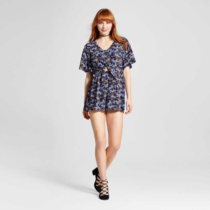 "• Model wears size 5/S and is 5'9.5""<br>• Junior's size 9/M is equivalent to Women's size 6/S<br>• Rayon for comfy wear and easy care<br>• Striking leopard print is so unique<br>• Short-sleeved romper has a relaxed fit<br>• A chic tie front allows you to show a hint of skin<br><br>Take a walk on the wild side in the Women's Leopard Tie-fron..."