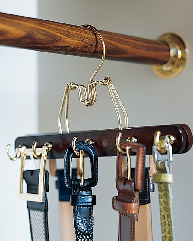 Portable Hooks  To create a belt rack that matches your other hangers (and doesn't require making holds in the wall), try this: Predrill a row of holes in alternating spots on both sides of a wooden clamp hanger, and screw in cup hooks. Make as many of these hangers as you need to accommodate your belts.