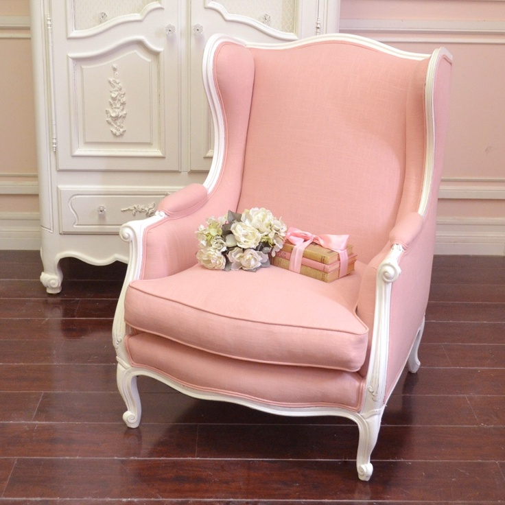 """This lovely wingback chair features brand-new pink linen upholstering. It is covered on all sides and comes with one removable cushion. The frame is painted our popular white and features darling Louis XV style feet. Perfect for the shabby chic style home! Accessories shown on the couch is not included.  30""""w x 30'd x 37""""t Seat height: 19""""t Seat depth: 22""""d"""