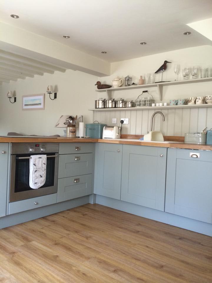 Coastal cottage kitchen, painted blue kitchen cupboards.