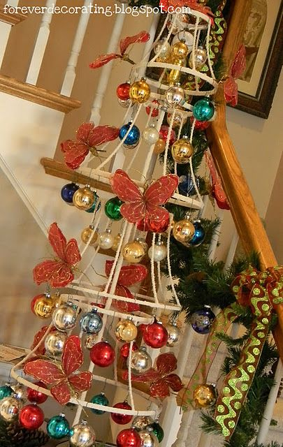 Creative tree made out of lampshades!!! Great way to display a collection of ornaments!