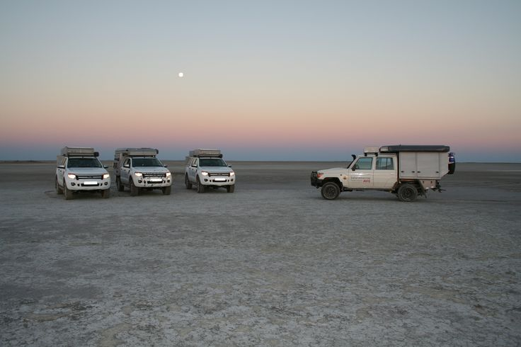 African sunset and the vehicles - Alu-Cab, Botswana