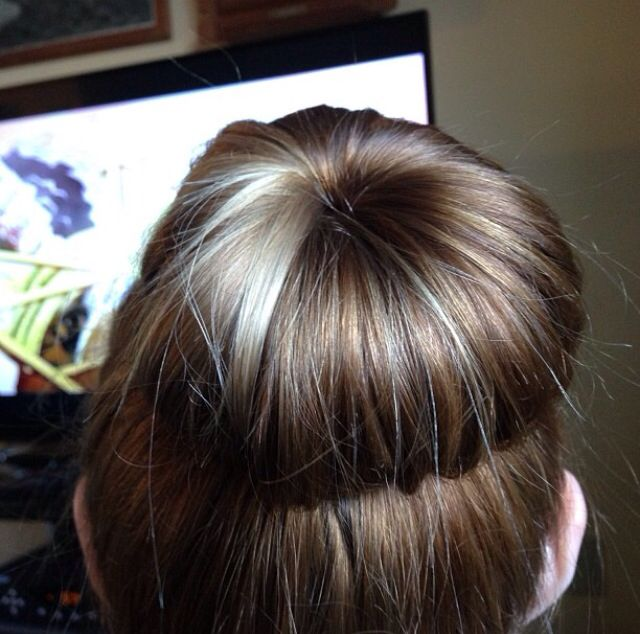 I want my hair back to this! Cute suck bun with natural looking brown hair and one blonde streak.