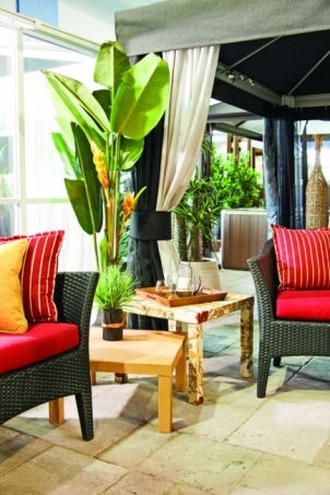 Personalize a table for your terrace:   Starting with bargain coffee tables and some weather-treated fabric, here's how to add a splash of color to your patio.