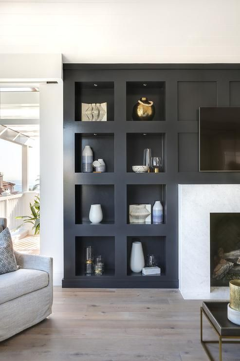 Custom black niche bedroom built-in wall shelf sur…