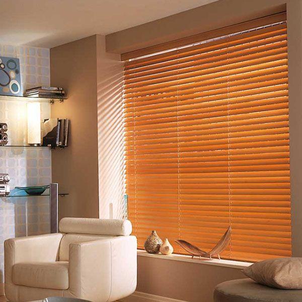 Honey Wooden Venetian blinds warm the room.