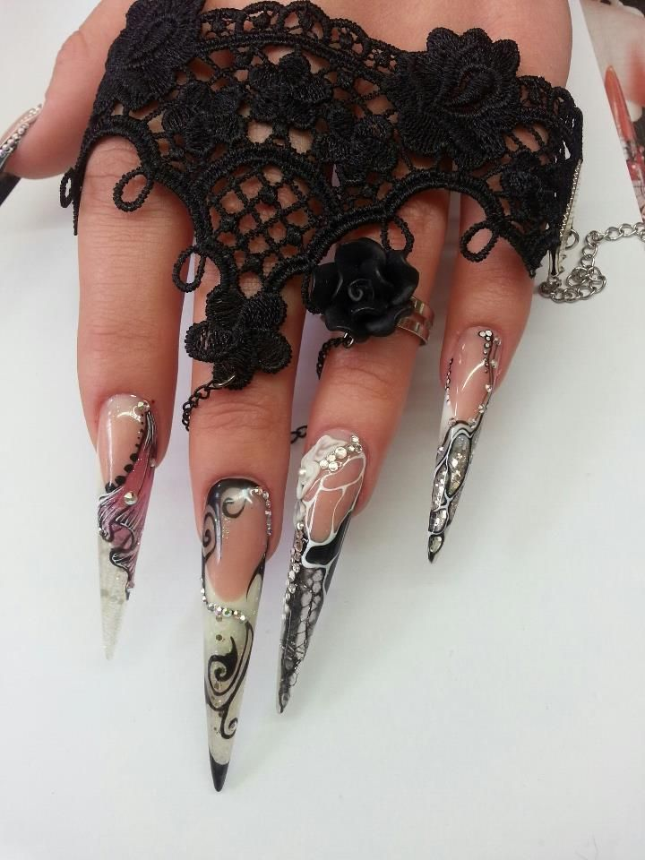 .Have to share Stiletto Nails...not my style but I do love the #nailart!  Nice!!
