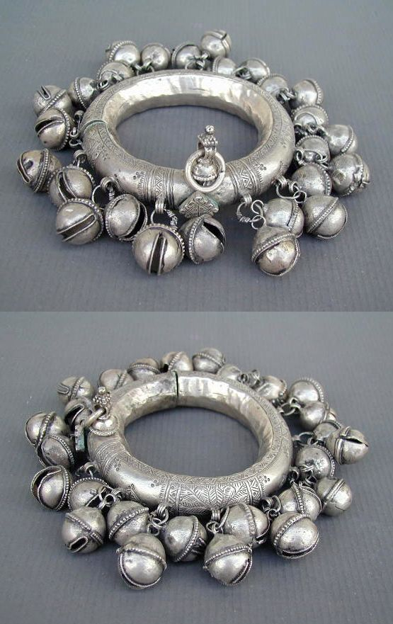 India   Old pair of hollow silver three part anklets from Rajasthan or Andhra Pradesh   With attached clusters of hollow silver bells ( gola ). Very good silver alloy, containing copper.   760$