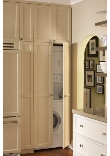 stacking washer/dryer with cabinet, double doors, storage above (would be white and slab panel to match walls and blend in)