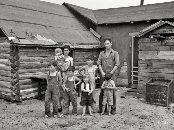 "June 1937. ""Art Simplot and family in front of their house near Black River Falls, Wisconsin."""