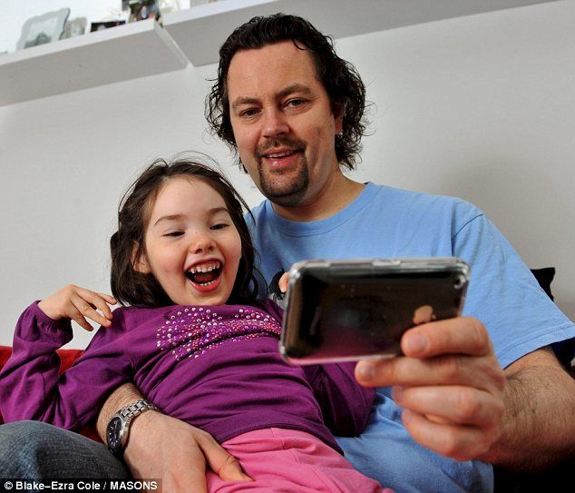 iComm App: Mia has severe cerebral palsy. She can tell her father Martin what she wants by pointing her eyes at different boxes on his iPhone