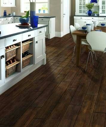 Love the wood grain tile against the white cabinets.