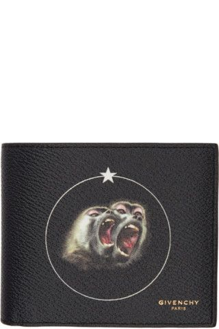 Coated canvas bifold wallet in black. Logo stamp in gold-tone and signature multicolor printed graphic at face. Card slots, note slots, and embossed logo at interior. Tonal textile lining. Tonal stitching. Approx. 4.5 length x 3.75 height.