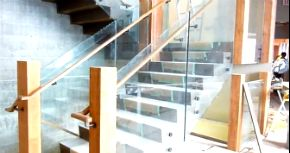 Wood and glass stair railings at Mica heli-skiing Lodge in remote Northern BC